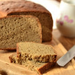 Freshly baked rye-wheat bread on a wooden board — Stock Photo