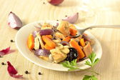 Baked chicken with vegetables and dried fruits — Stock Photo
