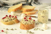 Baget with mushroom pate, herbs and pomegranate seeds — Photo
