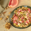Stock Photo: Grapefruit with granola, yoghurt and pistachios