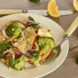 Broccoli with apple, red onion and walnuts — Stock Photo #36541013