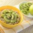 Healthy breakfast - milk oatmeal porridge with kiwi and pistachios — Stock Photo #39964803