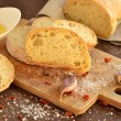 Stock Photo: Fresh bread - ciabatta, chili and garlic on old wooden board