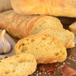 Stock Photo: Fresh bread - ciabatta, chili, garlic on wooden background