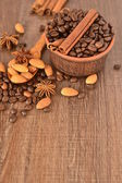 Coffee beans in a ceramic bowl and spices — Stock Photo