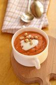 Carrot soup with sour cream and peanuts — Stock Photo