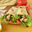 Pita bread stuffed with vegetables and fish — Stock Photo #49836199