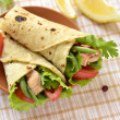 Pita bread stuffed with vegetables and fish — Stock Photo #50213015