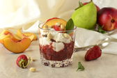 Dessert with whipped cream, fruit and nuts — Stock Photo