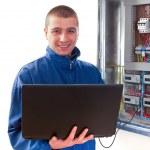 Handyman working with laptop — Stock Photo #23223262