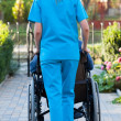 Pushing the patient in wheelchair — Stock Photo