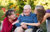 Granddaughter visiting grandpa — Stock Photo
