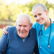 Kind doctor with patient — Stock Photo #34214435
