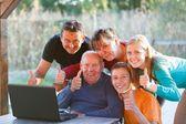 Family thumbs up — Stock Photo