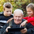 Grandfather learning something new — Stock Photo