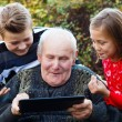 Stock Photo: Too old to use tablet?