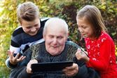 Too old to use a tablet? — Stock Photo