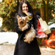 Stylish dog with owner gone shopping — Stock Photo