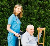 Professional Help for Elderly in Wheelchair — Stock Photo