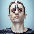 Portrait of the guy with scissors-mask on his face. - Stok fotoğraf