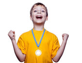 Happy exited boy with medal isolated on white — Stock Photo