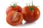 Tomatoes isolated on white — Stock Photo