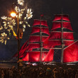 Light show and firework with a frigate with scarlet sails floating on the Neva River. — Stock Photo #48982811