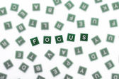 Focus - Clear Letters Against Blurred — Stock Photo