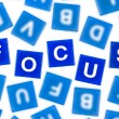 Stock Photo: Word FOCUS in Clear Blue Letters Against Blurred