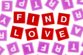 Words FIND LOVE in Clear Focus Against Blurred Letters — Stock Photo