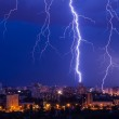 Lightning storm over city — Stock Photo #22026885
