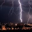Lightning storm over city at night — Stock Photo #26557283
