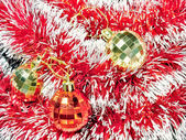 Christmas baubles on tinsel — Stock Photo