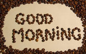 """Whole coffee beans spell out """"Good morning!"""" — Stock Photo"""