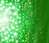 Green Festive Christmas elegant abstract background with bokeh lights and stars — Stock Photo