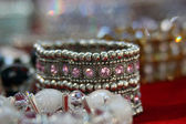 Bracelet with color stones on a background jewelery — Stock Photo