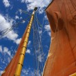 Red sail against skies — Stock Photo