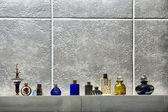 Row of cute perfume bottles — Stock Photo