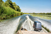 Motor boat goes on river — Stock Photo