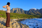 Girl looks at awesome sea and mountains — Stock Photo