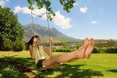 Delicate girl on swing — Stock Photo