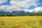 Pasture fields in front of amazing mountains — Stock Photo