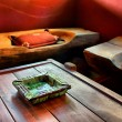 Stock Photo: Green marble ash-tray on table