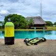 Scuba gear next to outdoor training pool — Stok fotoğraf