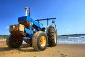 Tractor on beach — Stock Photo