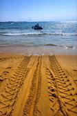 Tractor's wheel mark on beach — Stock Photo