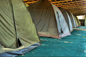 Row of old camping tents — Stock Photo