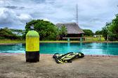 Scuba gear next to outdoor training pool — Stock Photo