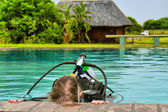 Diver goes down in training pool — Stock Photo