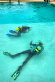 Two divers in training pool — Stock Photo
